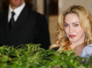 U.S. singer Madonna looks on as she leaves the new Hard Candy Fitness centre in downtown Rome